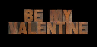 Wood type be my valentine. The words 'be my valentine' in old letterpress wood type Stock Photos