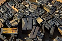 Wood type blocks. Collection of wood type blocks used in old printing machines Stock Images