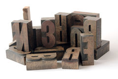Wood type grouping. Arrangement of ink-stained wood type Stock Images