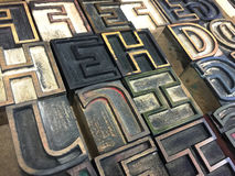 Wood type outline letters. Old letterpress wood letters in an outline font Stock Image