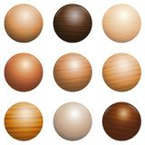 Wood Types Wooden Balls Different Textures Nine Colors. Wood types. Set of nine polished, varnished, textured decor balls - brown, dark, gray, light, red or Royalty Free Stock Images