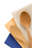 Wood utensils at table napkins Stock Photos