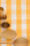 Wood utensils at table napkins Royalty Free Stock Photography