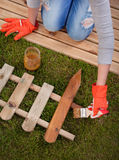 Wood varnishing. Applying protective varnish to a wooden fence Royalty Free Stock Photography