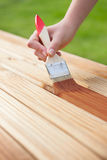 Wood varnishing. Applying protective varnish on a wooden furniture Stock Images
