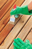 Wood varnishing. Applying protective varnish on a wooden furniture Royalty Free Stock Photo