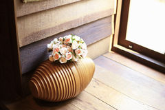 The wood vase for put the flowers, and vintage background. The wood vase for put the flowers, as wood and vintage background or print card Royalty Free Stock Image
