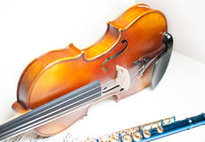 Wood violin body part with blue flute and score Royalty Free Stock Photography