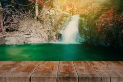 wood walk way with waterfall in rain forest royalty free stock photos