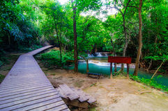 Wood walkway on a wild park to the Waterfall Huay Mae Kamin Stock Photography