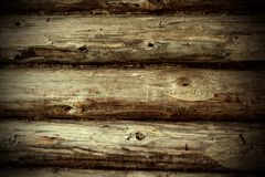 Wood wall background. Abstract background showing fragment of an old wooden house wall facing closeup with log wood texture visible. Landscape orientation Stock Image