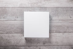 Wood wall and blank paper card Stock Image
