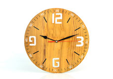 Wood wall clock face isolated on white background Royalty Free Stock Photos