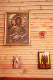 Wood wall with orthodox holy painting called icon Royalty Free Stock Image