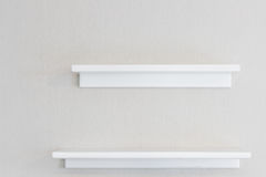 Wood wall shelf. Empty white wood wall shelf and white concrete wall background Royalty Free Stock Photos