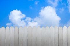 Wood wall and skies Royalty Free Stock Images
