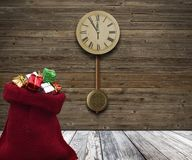 Wood Wall With A Clock Showing The Time Is Five Minutes To Twelve Royalty Free Stock Image