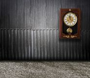 Wood Wall With A Clock Showing The Time Is Five Minutes To Twelve Stock Images