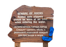 Wood warning sign on beach Stock Photos