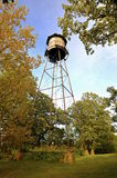 Wood water tower in backyard Royalty Free Stock Image