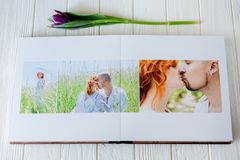 Wood wedding photo book. Happy young couple in love. Bride and groom walking of wedding day. White background stock photos