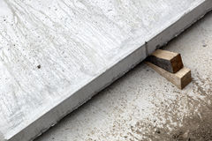 Wood wedges concrete slab Royalty Free Stock Images
