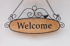 Wood welcome sign hanging on wall Royalty Free Stock Photos