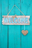Wood welcome sign with heart hanging on painted door Stock Photos