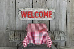 Wood welcome sign over picnic table Stock Images