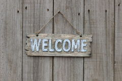 Wood welcome sign on wooden fence Royalty Free Stock Images