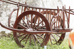The wood wheel of a cart or buckboard. Royalty Free Stock Photos