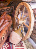 Wood wheel and and different sorts of meat at market Stock Photos