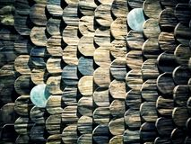 The wall. The wood which has been cut into a small piece on the one side was made to the arc. When the overlap is stacked, it is similar to the colored fish Stock Images