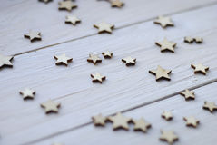 Wood white background  with stars Stock Images