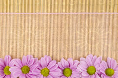 Wood, wicker background with pink ribbon and flower Stock Photo