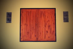 Wood window. And glass block in the wall Royalty Free Stock Photography