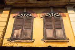 Wood window and old building in thailand Stock Photography