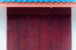 Wood window old Thai style traditional art with blue roof. Stock Photography
