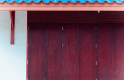 Wood window old Thai style traditional art with blue roof. Royalty Free Stock Photo