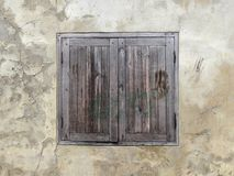 Wood window on old wall. Background Stock Photos