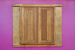 Wood window on pink wall Royalty Free Stock Images