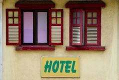Wood window shutters and hotel sign Royalty Free Stock Photos