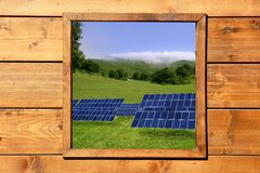 Wood window solar plates meadow view Stock Images