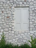 Wood window vs Stone wall. A wooden window Royalty Free Stock Images