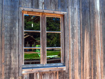 Wood window. Window on an weathered wood siding clapboard house with antique window Stock Photos