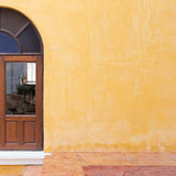 Wood window on yellow cement mortar wall Royalty Free Stock Photo