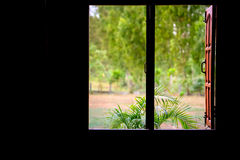 Wood windows in a dark corner terrace home Stock Photos