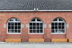 Wood windows with red bricks wall arched windows Royalty Free Stock Photos