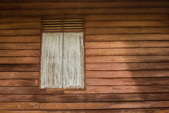 Wood windows and wood siding. Royalty Free Stock Images