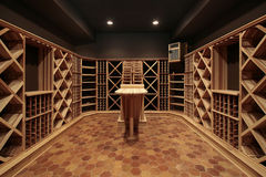 Wood wine cellar. Butcher block wine cellar with wood table Stock Image